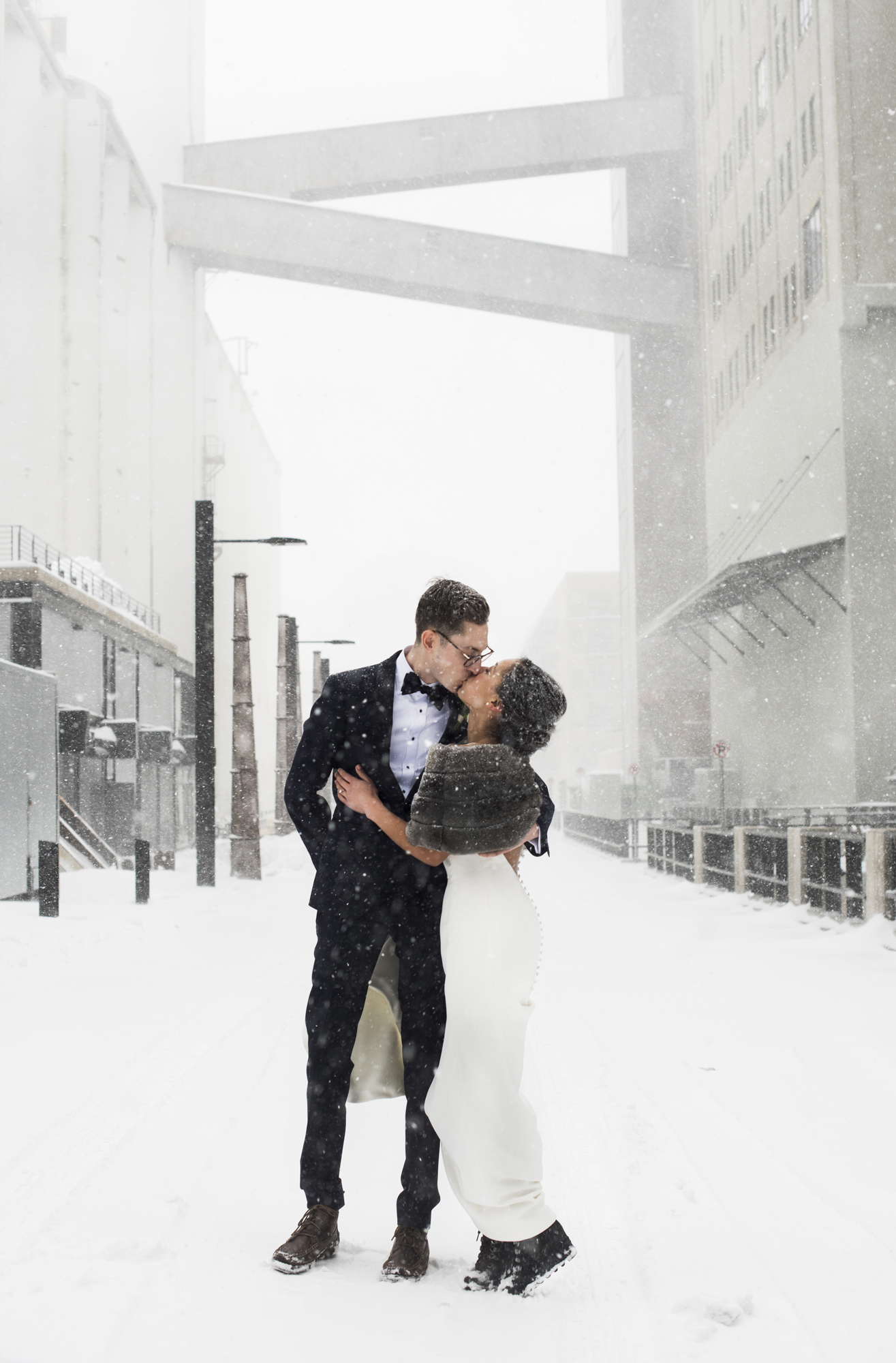 Hannah and Elliot brave the 2018 April snowstorm and ran outside for a quick photo.  Wedding by:  Melissa Hesse