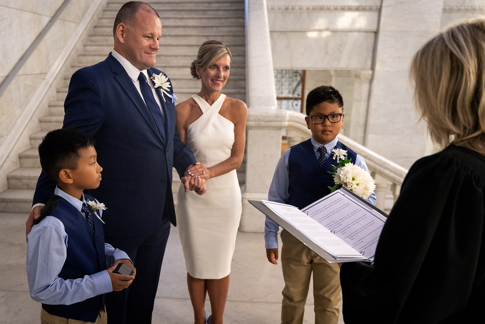 Jeff and Diane stand at the Courthouse with their two sons as they get married.  Wedding by:  Andy Yelken