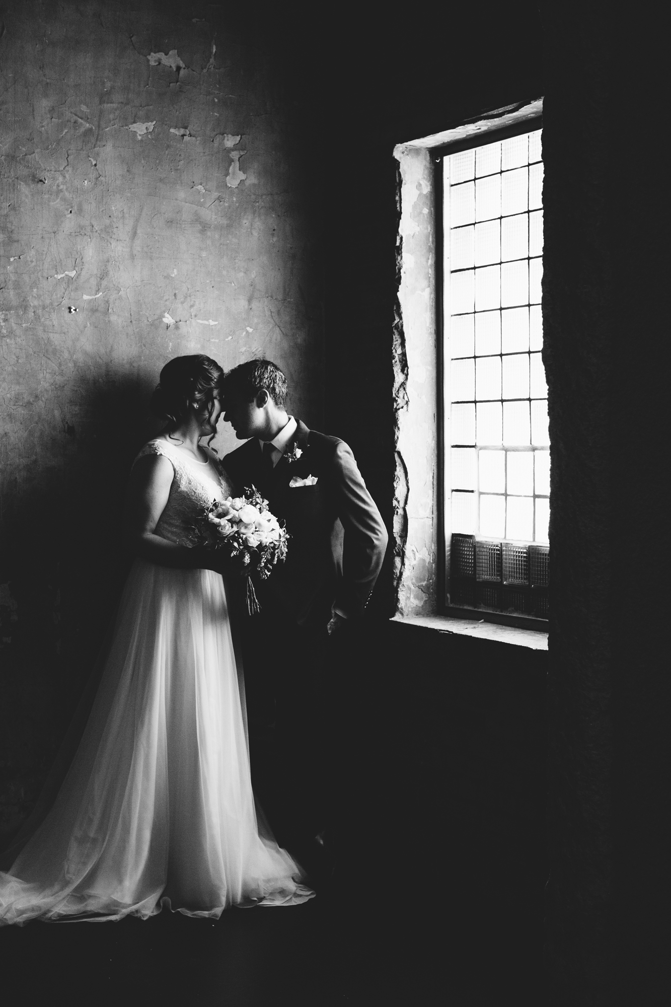 Laura and Domenic stand in gorgeous light at their wedding venue,  Aria .  Wedding by:  Jess Ekstrand