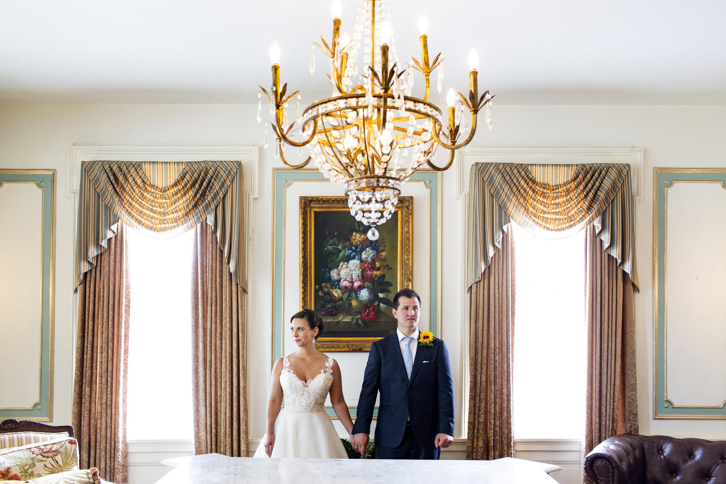 Jeanie and Adam stand inside  300 Clifton  where they got married.  Wedding by:  Jess Ekstrand