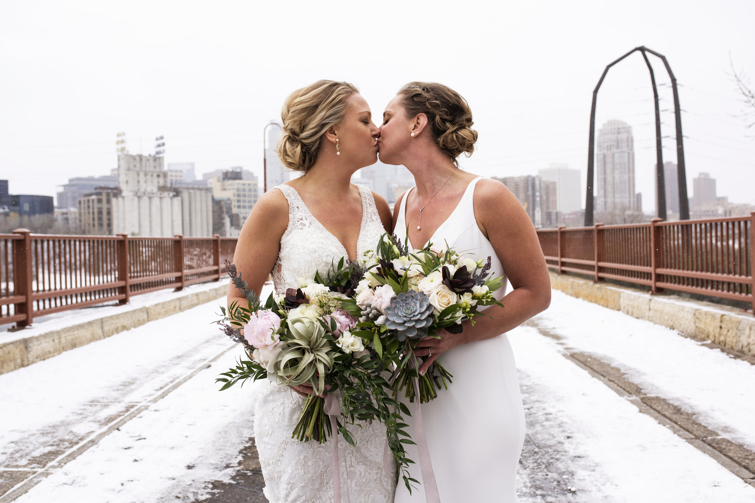 The cold and snow didn't stop Katie and Amanda from photos on the Saint Anthony Bridge.  Wedding by:  Melissa Hesse