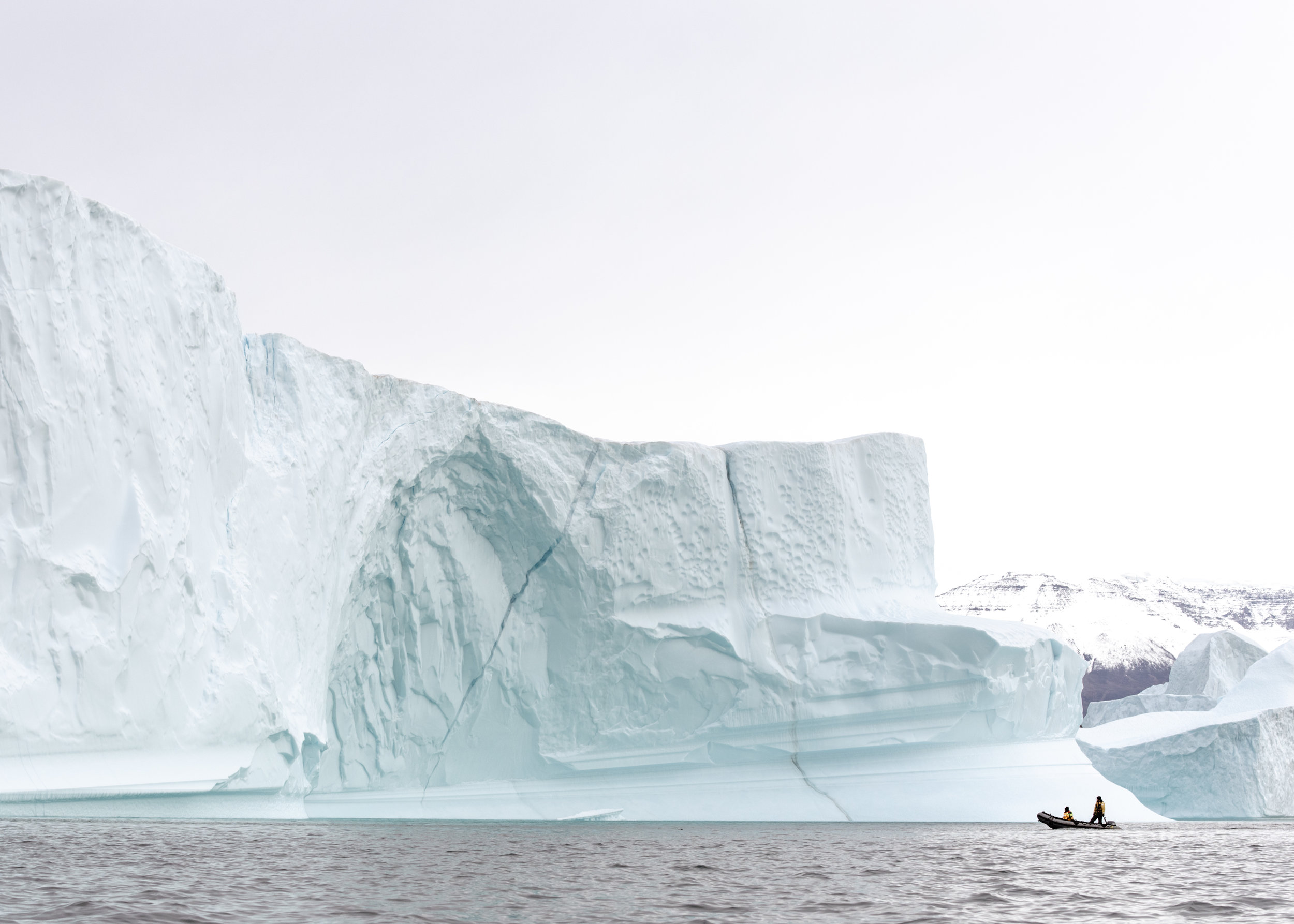 Iceberg city - A city of ice, a city of coldBasalt cliffs fortify withSky above and ocean belowArctic cathedrals, wint'ry chateauxStillness surrendered, ontoA morning sunrise, cloud aglowCoffee in hand and a new day aheadOur ship cuts the surface hereJust like a tailors scissors' flow
