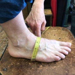 Measure your instep from inside to the outside of your foot. Measure from floor to floor.