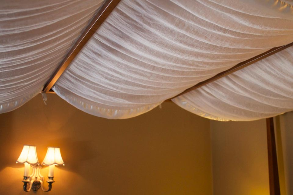 Pillowy and plush, the canopy of the queen, four-post bed lends an air of luxury to your accommodations in Room 3.