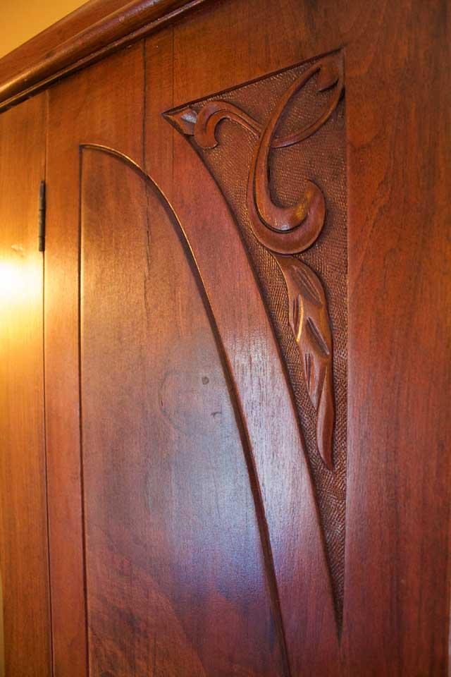 Details of antique, carved wooden armoire in Burlington's Willard Inn.