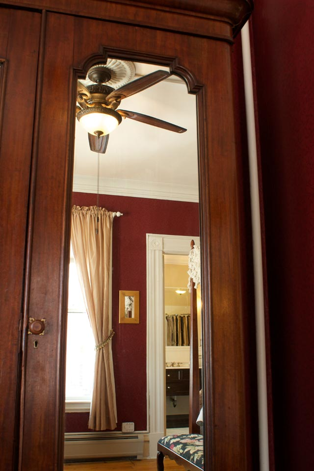 Mirrored, Antique armoire in champlain lookout guest room at the Willard St Inn