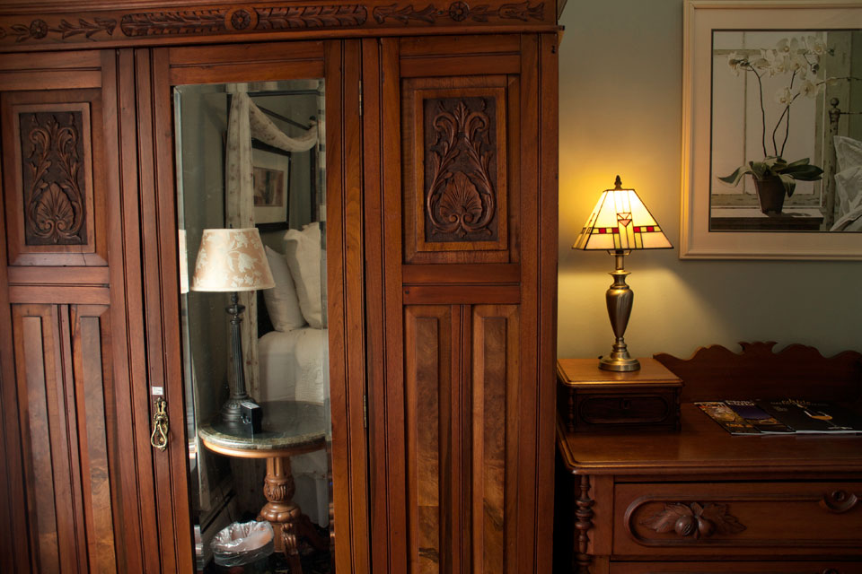 Victorian wardrobe add to the Casually elegant accommodations of Room 8 at this Burlington, VT bed and Breakfast
