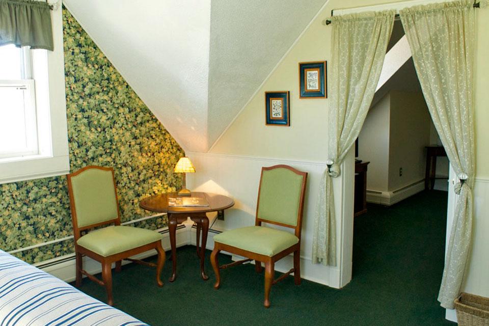 Sitting area of the bedroom in Suite Larkin at WSInn in Burlington, VT.