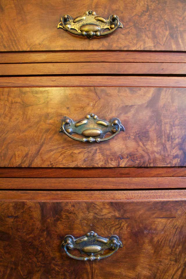 Maple Burl highlight the antique wooden dresser in the Rose Garden room.