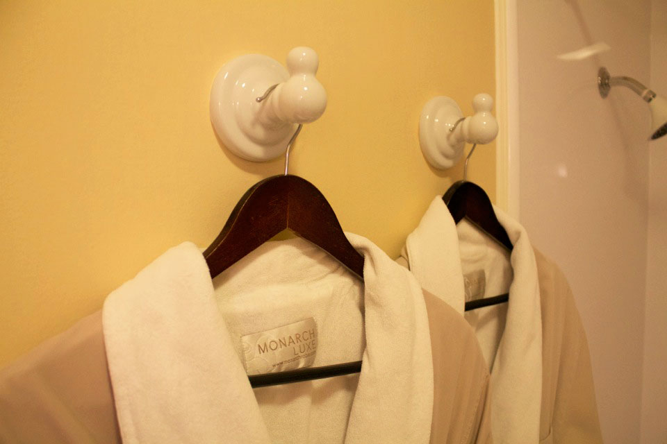Soft bathrobes waiting to relax in while staying in the Tower Room.