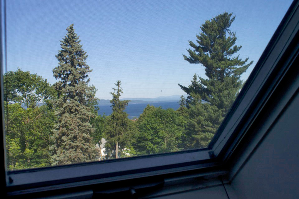 View of Lake Champlain and Adirondack Mountains from Angled window in Room 16 at Burlington, Vermont's WillArd Street Inn