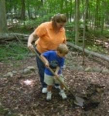 Midwife extraordinaire Pam Kolanz and #2 son bury his placenta.