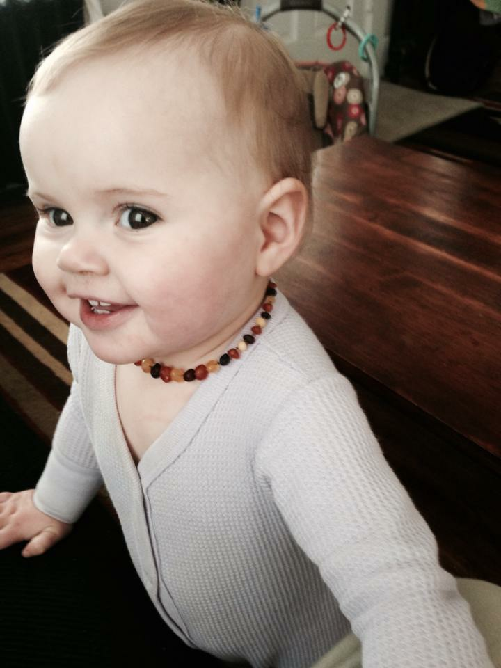 baby-with-necklace