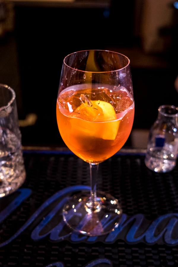 Aperol Spritz is made with Aperol and Ruffino Prosecco and seltzer water.