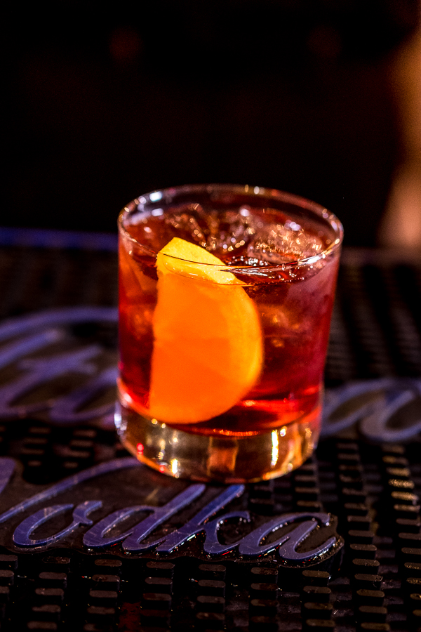 Negroni made with Bulldog Gin, Campari and Cinzano 1757 Sweet Vermouth garnished with an orange slice.