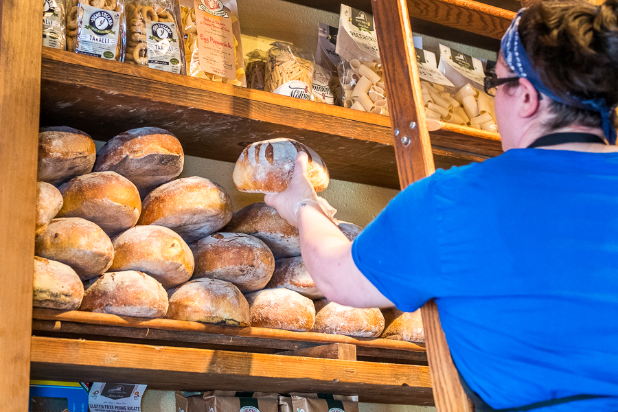 Stocking the shelves each morning with Sourdough.