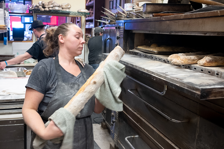 Sara checking the progress on a loaf of ciabatta.
