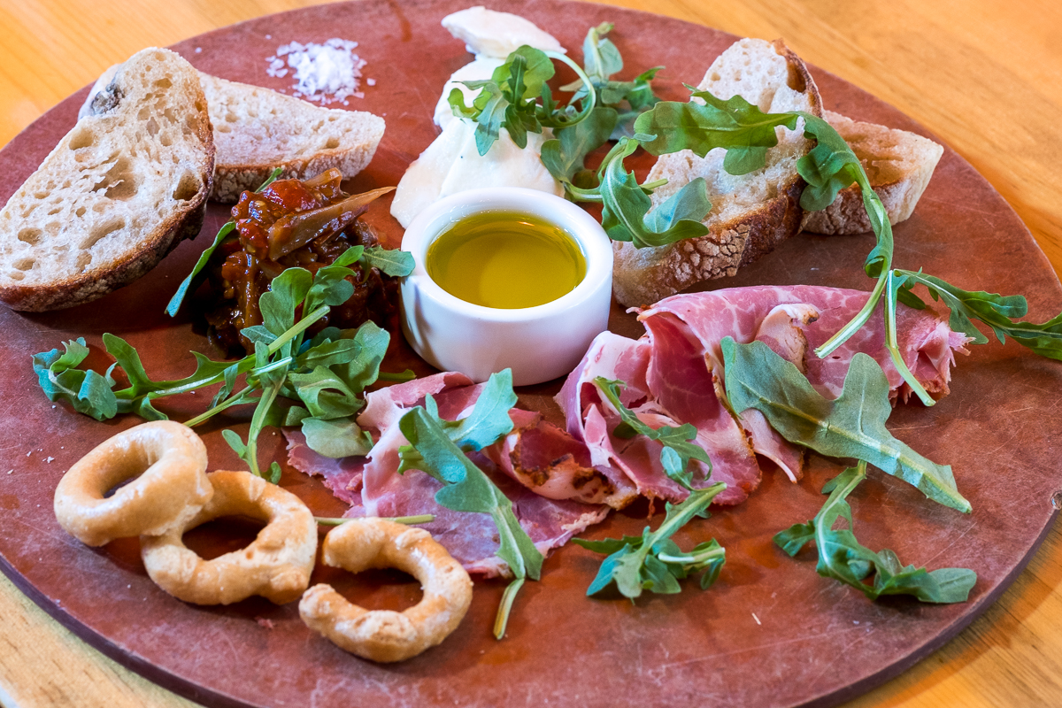 M'tucci's Italian Charcuterie Board C: Capicola, Sweet Onion & Tomato Agrodolce, Smoked House Mozzarella, House Made Bread and Taralli.
