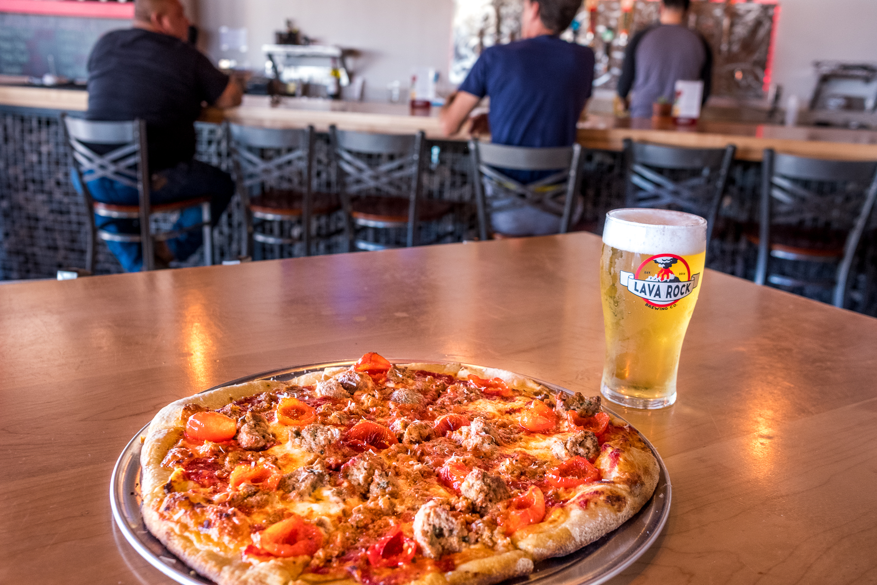 M'tucci's Sausage Pizza and Lava Rock Valles Lager