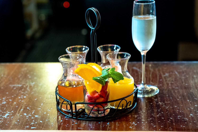 Our new Mimosa tray: Prosecco with Orange, Grapefruit, and Blood Orange Juice and Lavendar Honeydew Peppercorn Shrub, plus fresh fruit garnish - Get Creative!