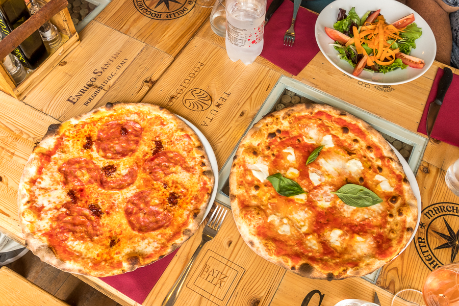 In Bolgheri,Pizza with Salami and the left and, of course, Margherita on the right.