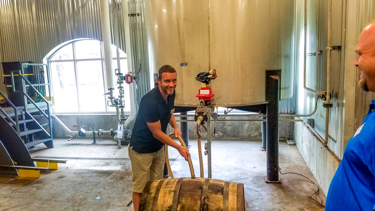 Austin filling the 53 gallon barrel with what will become M'tucci's Private Select Maker's Mark Bourbon.