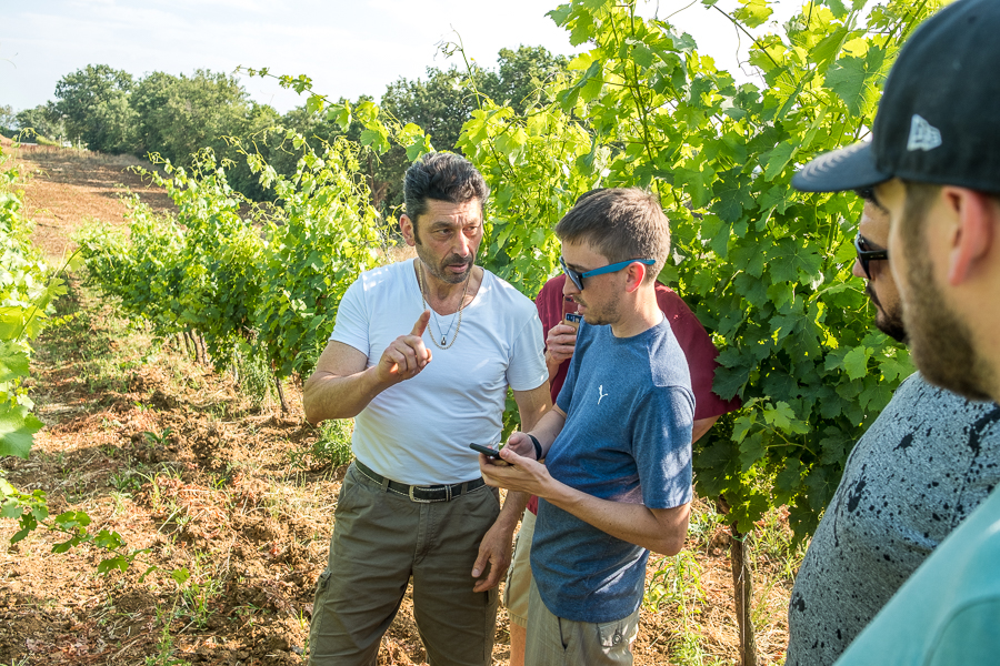 John talking with a winemaker in Tuscany, with the help of a translator app.
