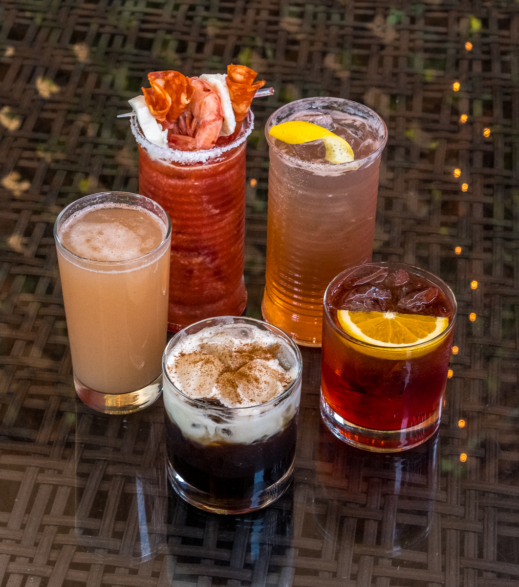 Clockwise from the front: Italian Iced Caffé, Bellini, Bloody Mary, Amalfi Coast High Ball, Negroni Sbagliato. Below: Aperol Spritz and the Mimosa Bar (Prosecco with a selection of juices).