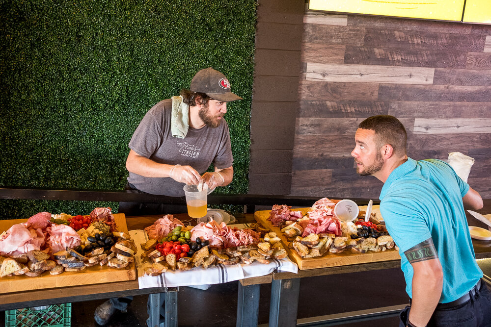 Chef/Partner Shawn and Managing Partner Austin setting up for a catering event.