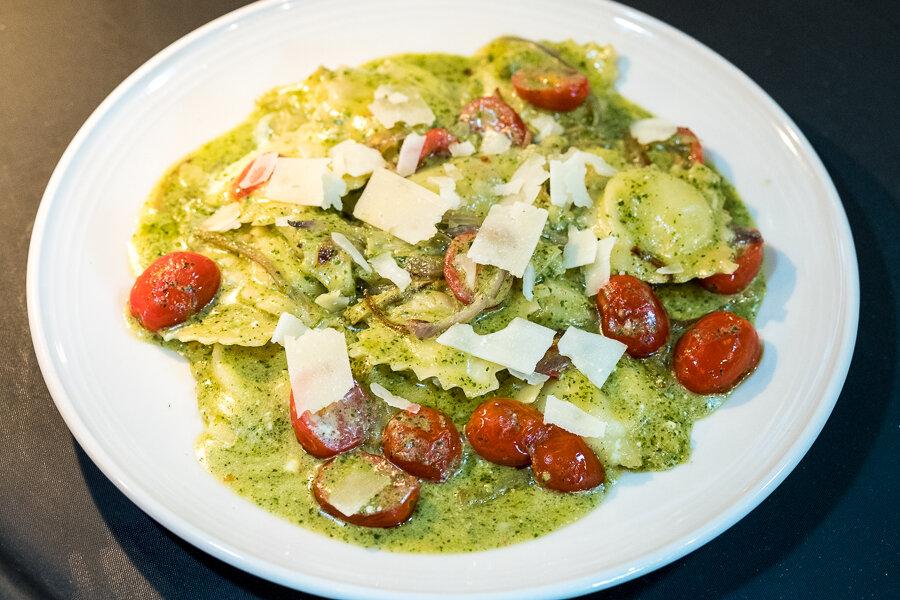 Pesto Ravioli only at M'tucci's Moderno - Homemade Ricotta & Pesto Ravioli, Roasted Artichoke, Shallots, Grape Tomato, Lemon + Pesto Cream Sauce, Shaved Parmesan
