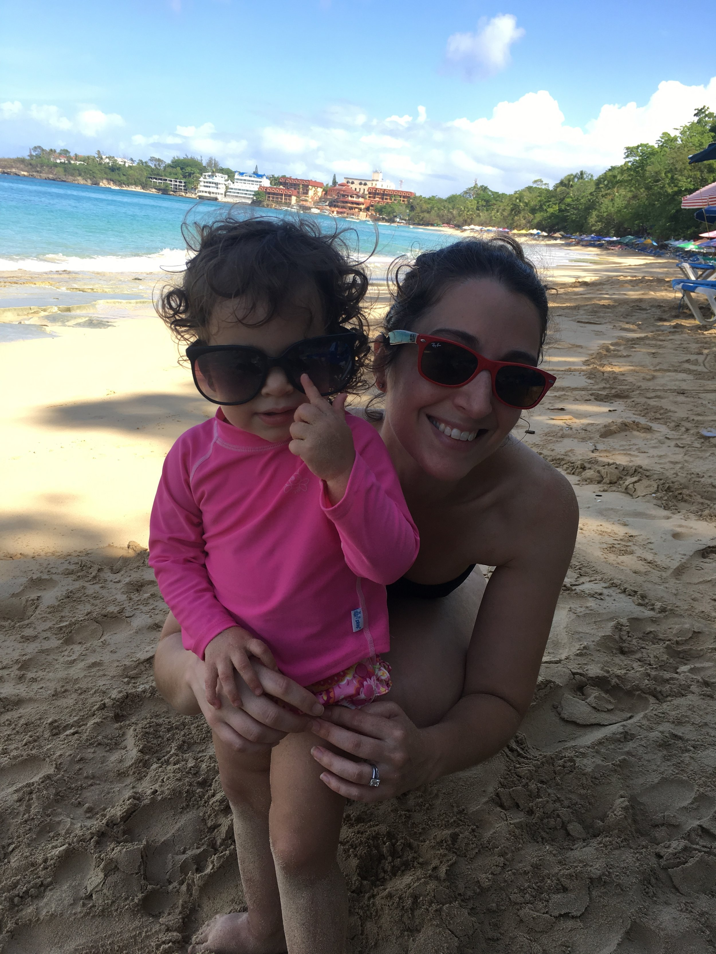 Hiding behind my 2 year old on the beach.