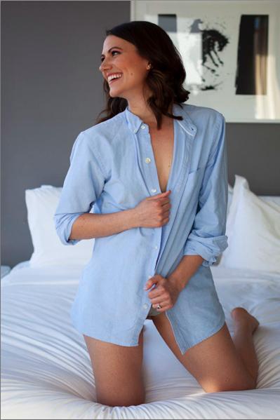 Happy-woman-in-mens-button-down-brooklyn-boudoir