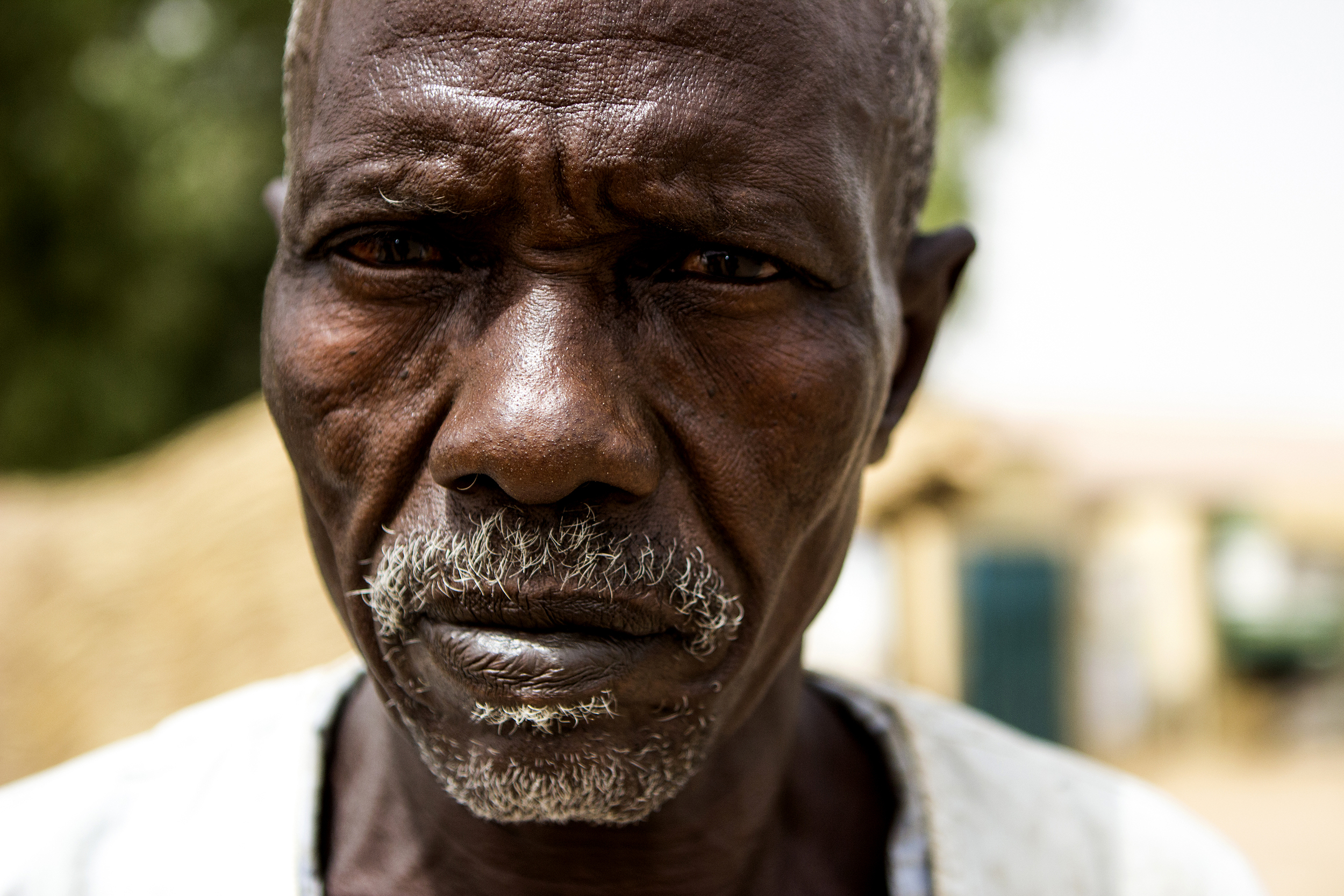 """A retired Nigerian military soldier is seen in Yola, Nigeria, on March 4, 2015, at an informal camp for people displaced by Boko Haram violence. He says he's disappointed in the government's response to the insurgents. """"They're habitual criminals,"""" he said. """"Why are we not fighting them as such?"""
