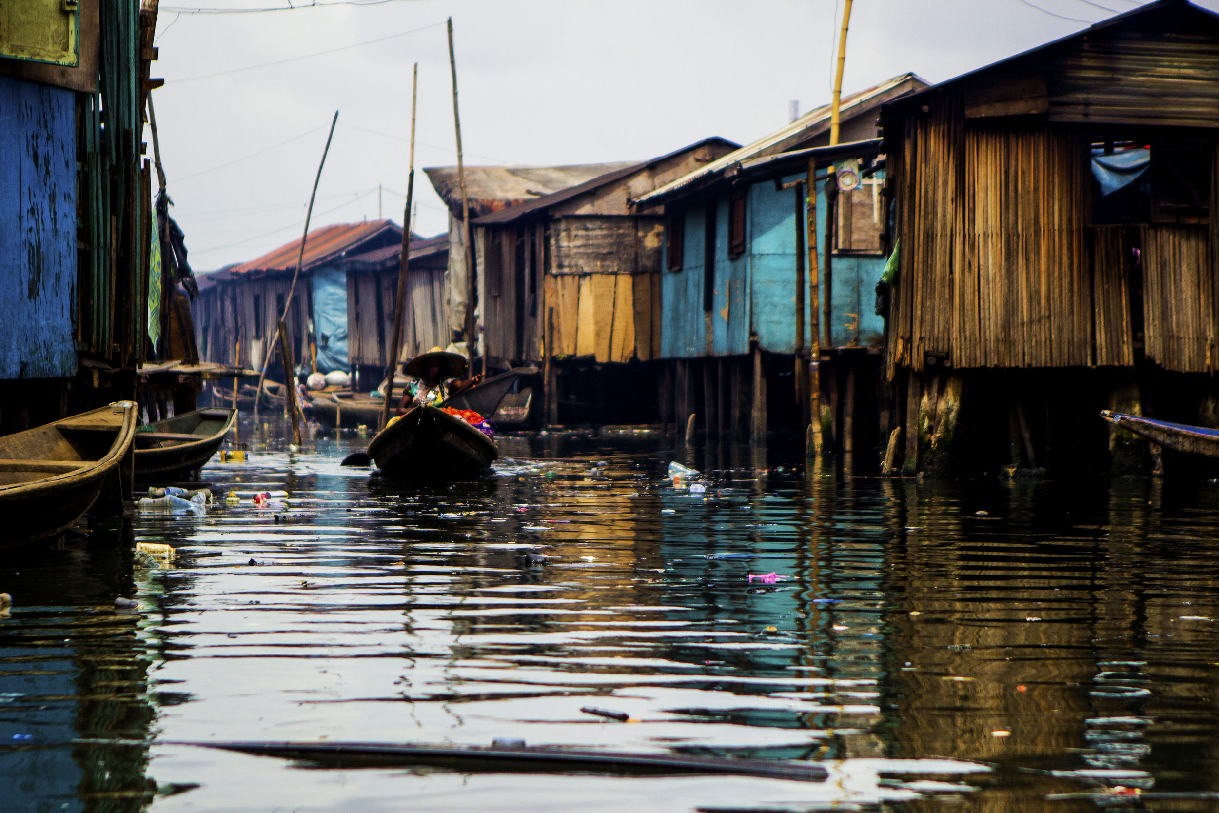 Lagos, Nigeria. Feb. 26, 2015. A resident of the Makoko floating villages uses a canoe to navigate the area's passageways.
