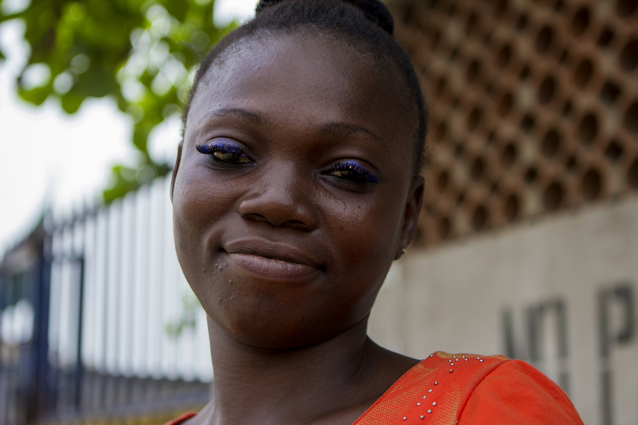 A woman poses for a photo while waiting for her bus to work in Lagos, Nigeria on Feb. 25, 2015.