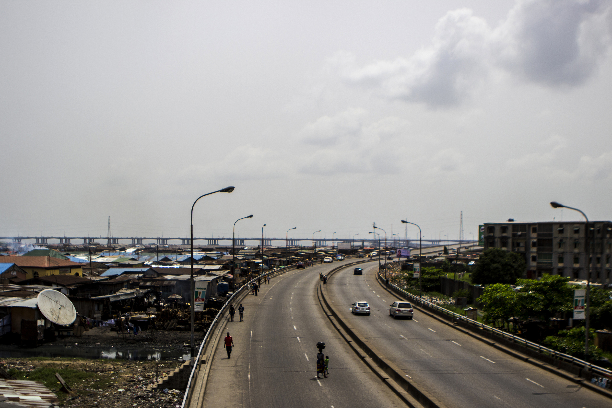 Lagos, Nigeria. Feb. 26, 2015. The floating village of Makoko sits just beside a highway overpass in Lagos.