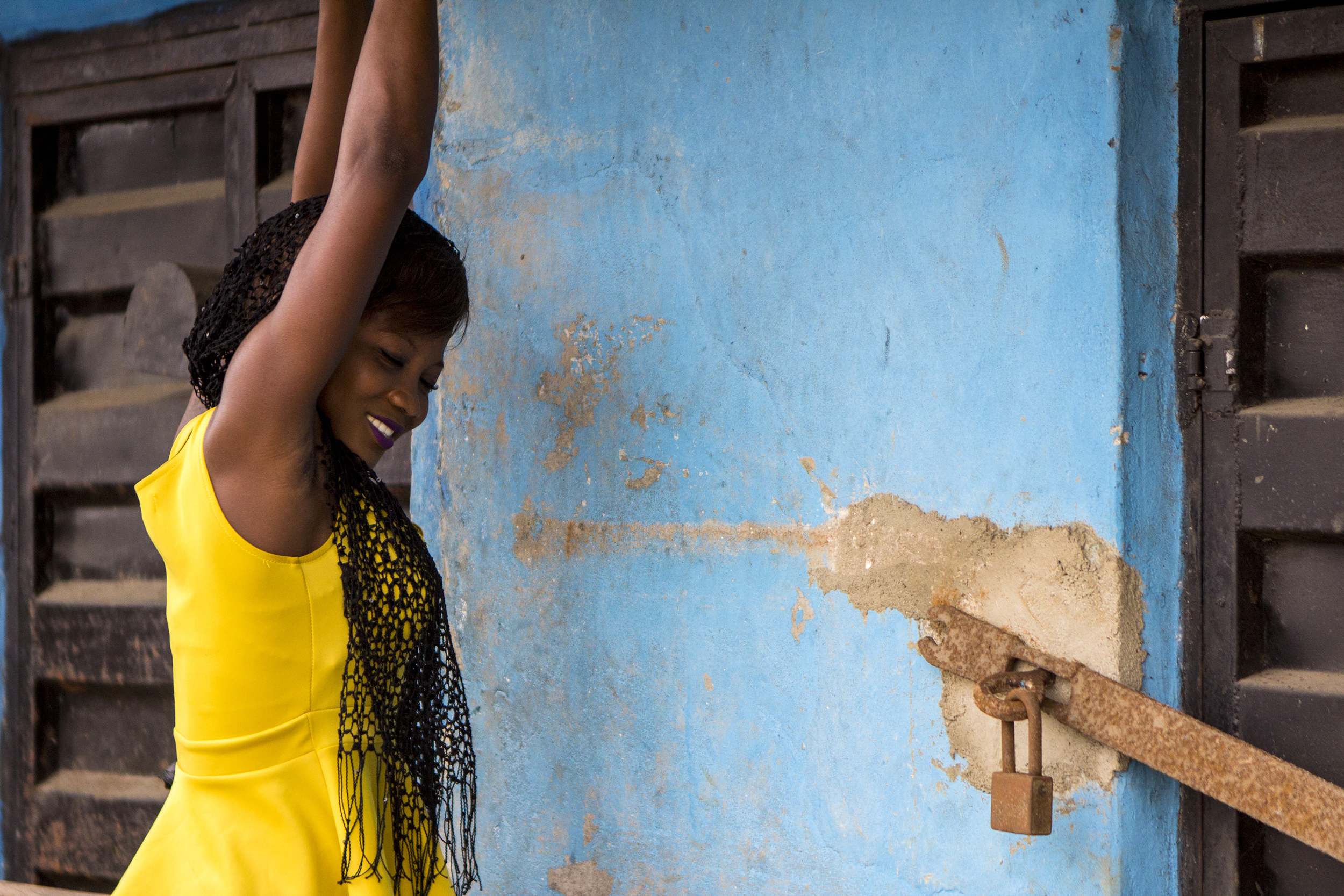 A business owner in Lagos, Nigeria opens her shop for business on Feb. 25, 2015.