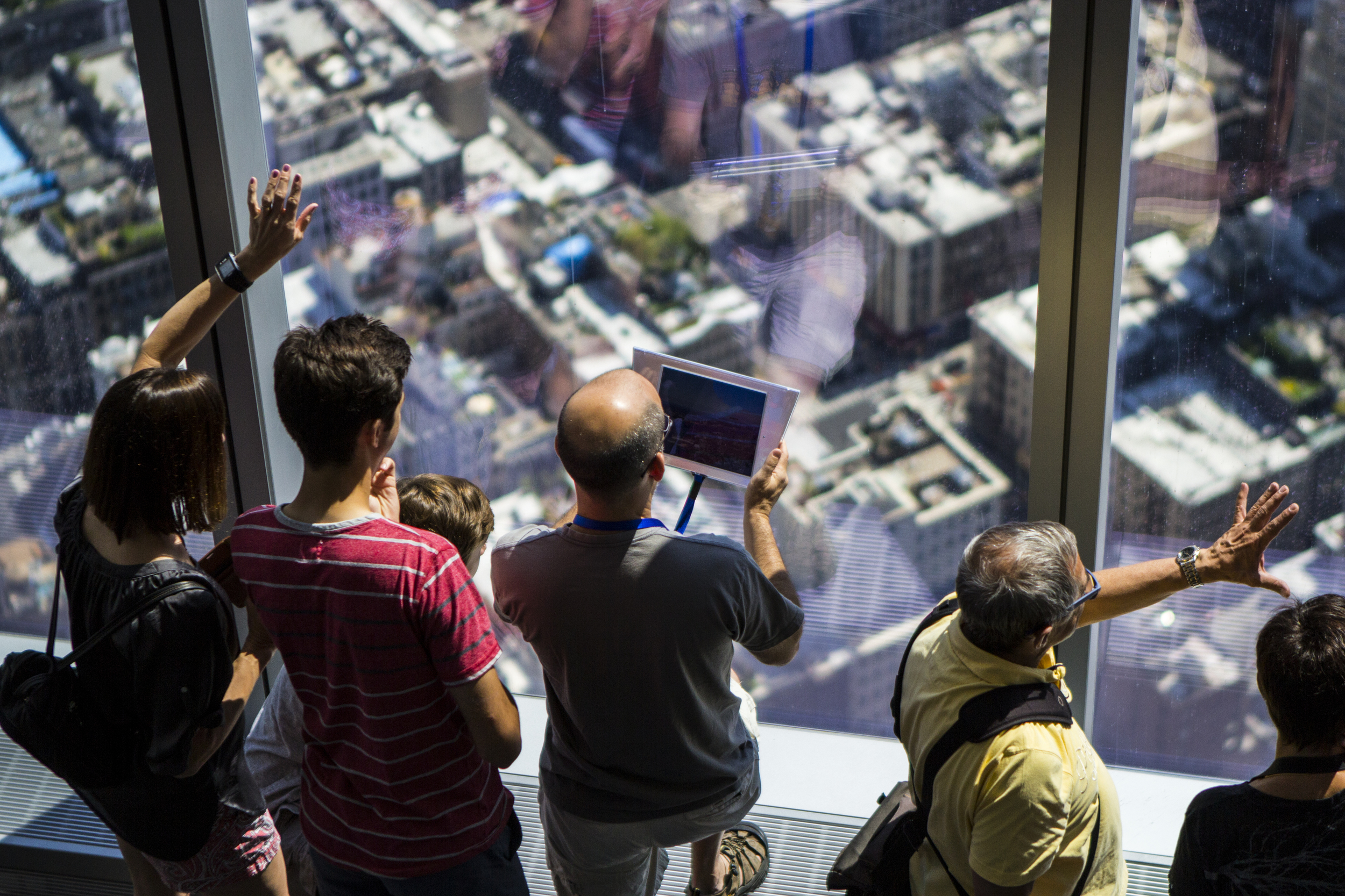 Tourists attend the opening of the One World Trade Center Observatory in New York City on May 29, 2015.    Shot for the Village Voice.