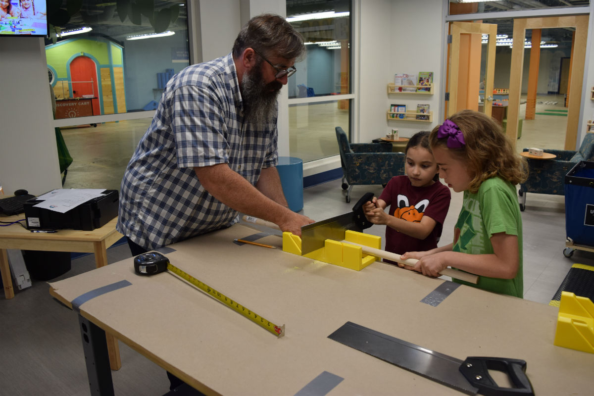 Aaron Kishbaugh helps students during a summer boot camp.