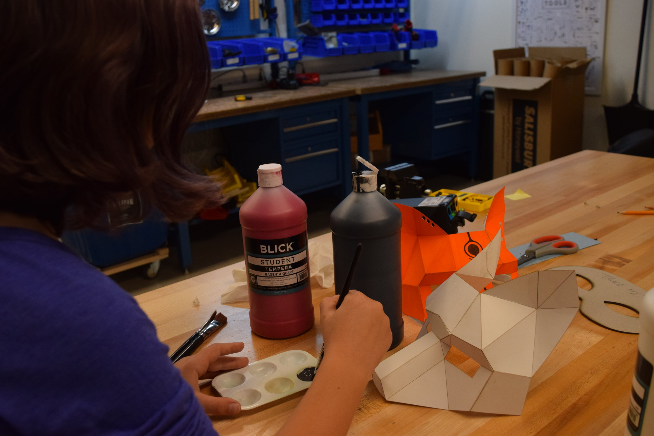 Emma mixing paint for her fox mask