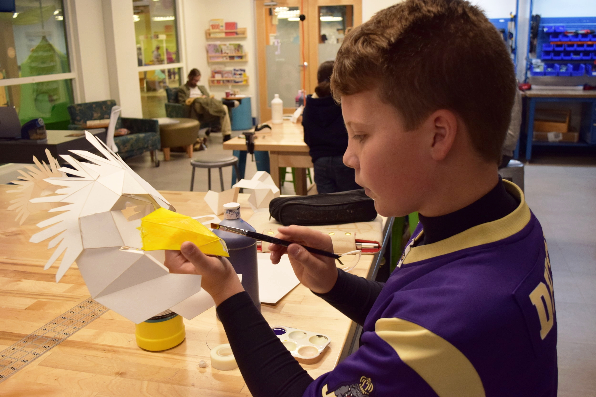 Jackson painting his modified, gladiator bird mask for the JMU football game