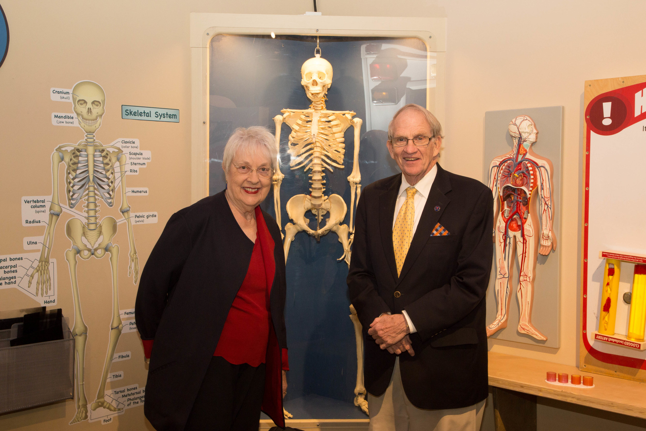 Charles, a retired physician, and wife Mary pose next to the skeleton, a staple of the museum for 15 years!