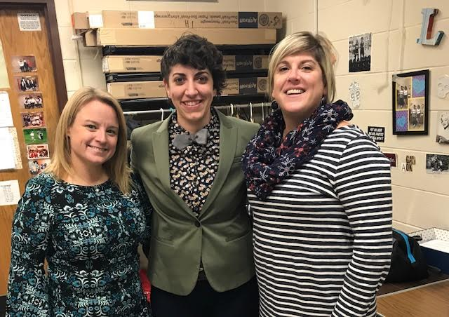 Teacher, Heather Kennedy, pictured in the middle, has incorporated the issue of human trafficking into her classroom curriculum.
