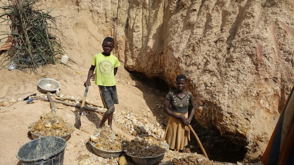 PHOTO: A boy and a girl work in a small gold mine in Amansie West district, Ghana. © 2016 Juliane Kippenberg for Human Rights Watch