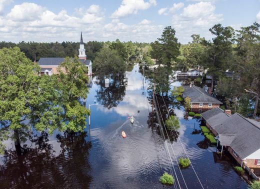 PHOTO: Kayaks are paddled up Long Avenue past flooded sections of the Sherwood Drive community of Conway, S.C., Sunday, Sept. 23, 2018 after Hurricane Florence. Homes were submerged deeper than ever in flood waters that set historic records. Jason Lee, The Sun News via AP