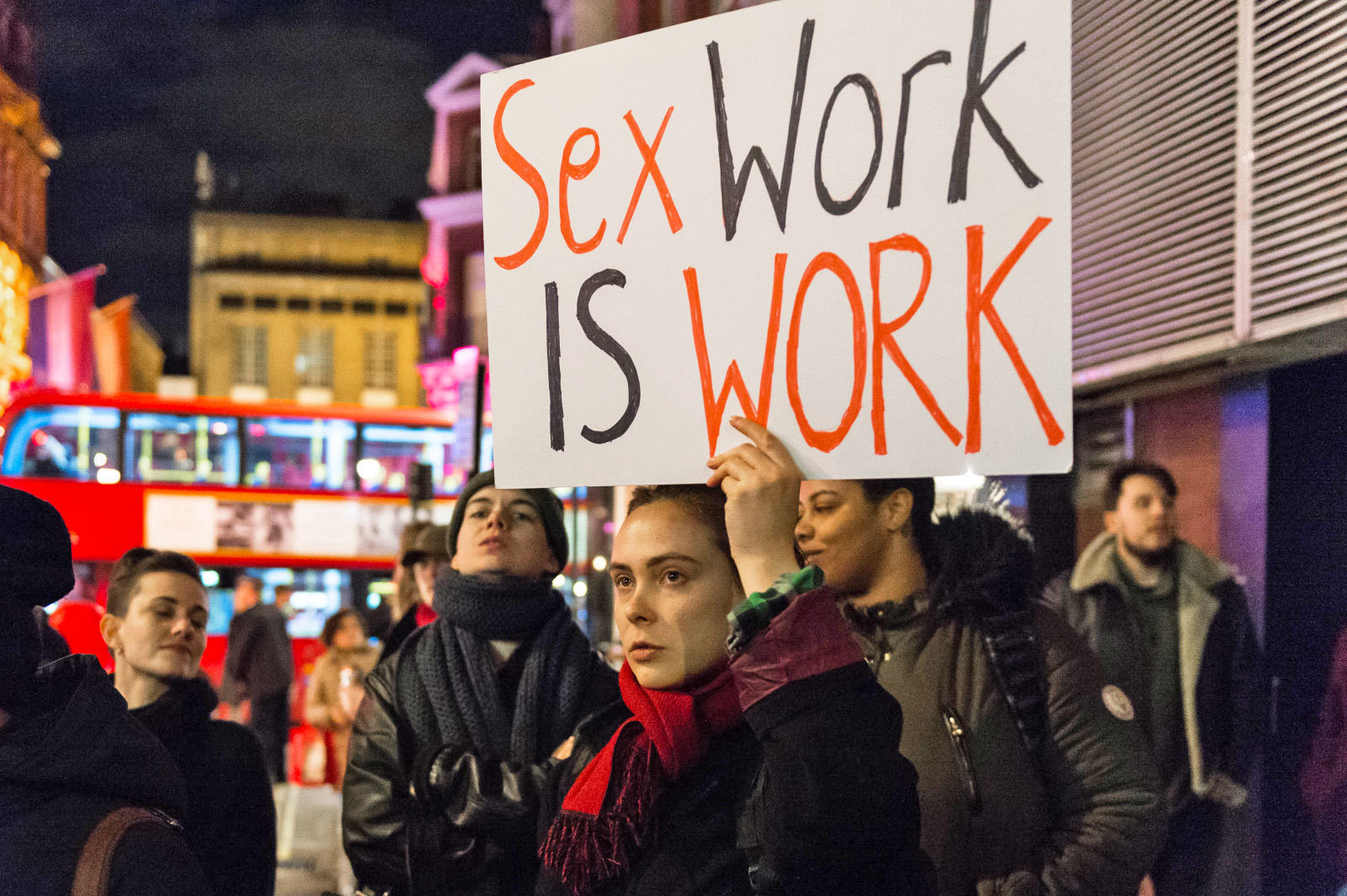 PHOTO: Protester holds a placard supporting sex workers in London. Barcroft Media via Getty Images