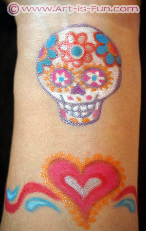 I drew a sugar skull (p.104) on the inside of my wrist and a heart bracelet (p.25) beneath it, using colorful eyeliner and tattoo gel pens.