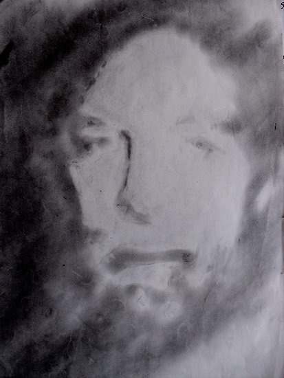 Self-portrait created by smudging graphite powder onto paper