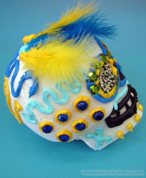 How to Decorate Sugar Skulls with Feathers