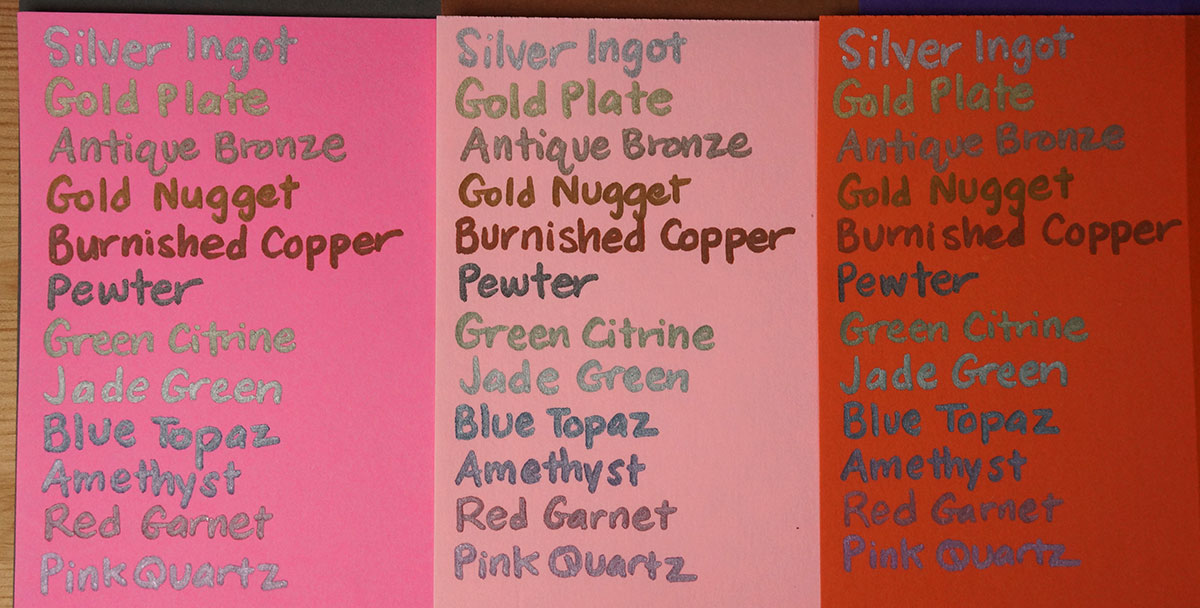 Spectrum Noir Metallic Markers on fluorescent pink, pale pink and orange papers